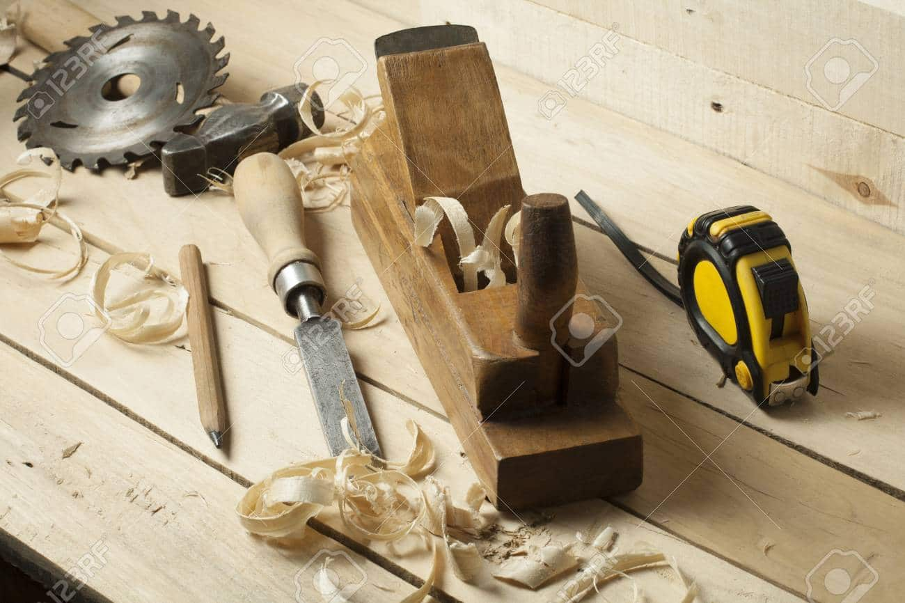 Carpentry concept.Joiner carpenter workplace. Construction tools on wooden table with sawdust.