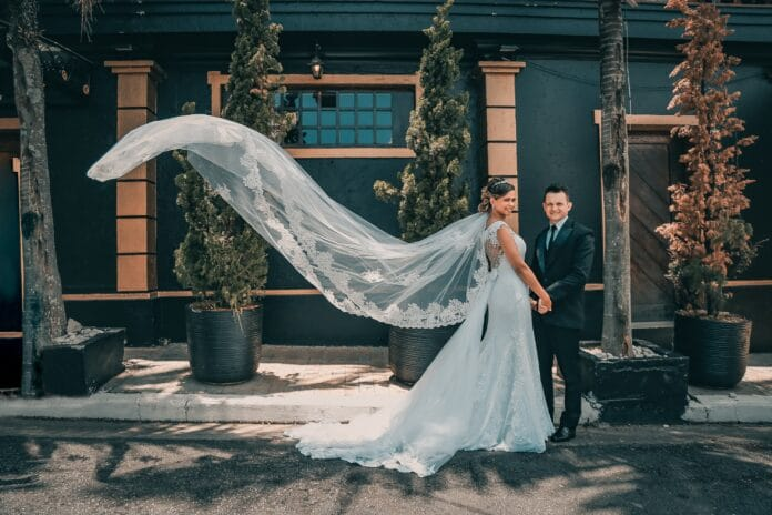 Couple in their wedding attires outdoors